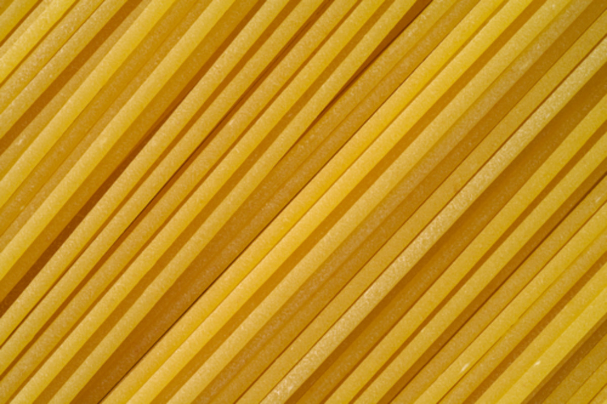 Premium Artisanal pasta - buff coloured with rough surface. Image:  Claudio Baldini|Shutterstock.com
