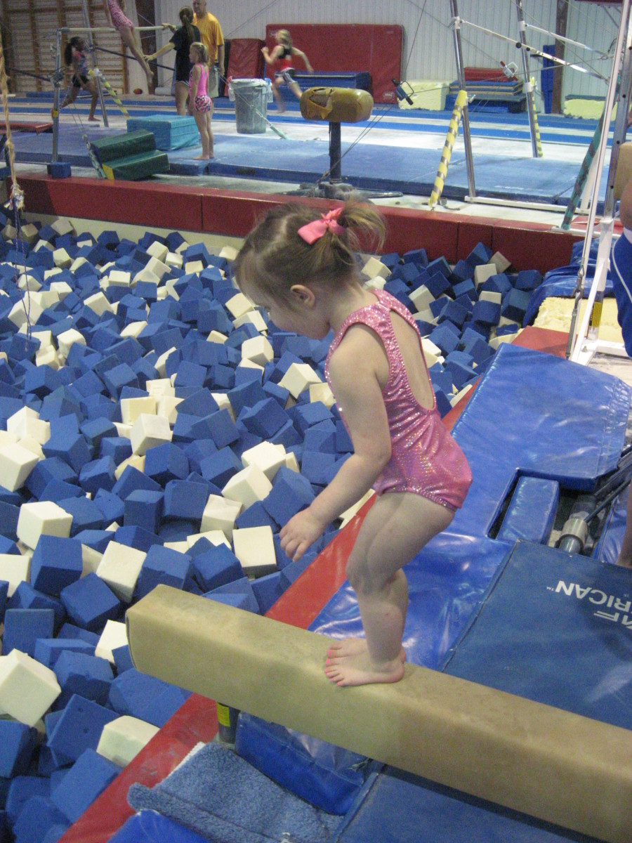 My three-year-old granddaughter is just getting started with gymnastics classes, following in her gymnast-mom's footprints.