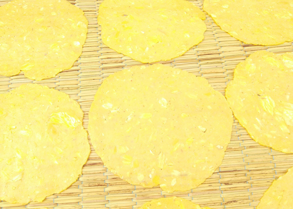 Mature and unripe jackfruit pressed 'papad' is very popular for oil frying and eating as snack food