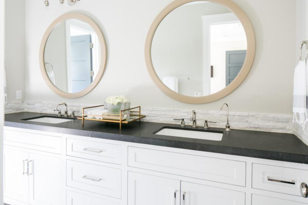 The master bathroom is new two sinks, black countertop, mirrors and cabinets!