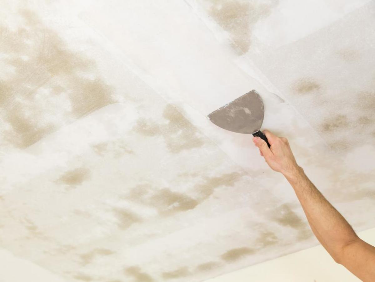 Remove the popcorn ceiling and paint the ceiling.