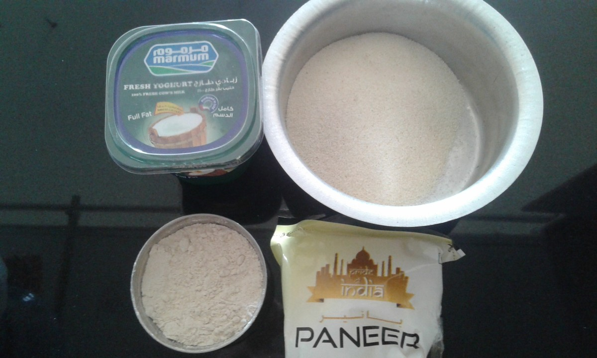 Ingredients for the batter: curd, suji, wheat flour and paneer