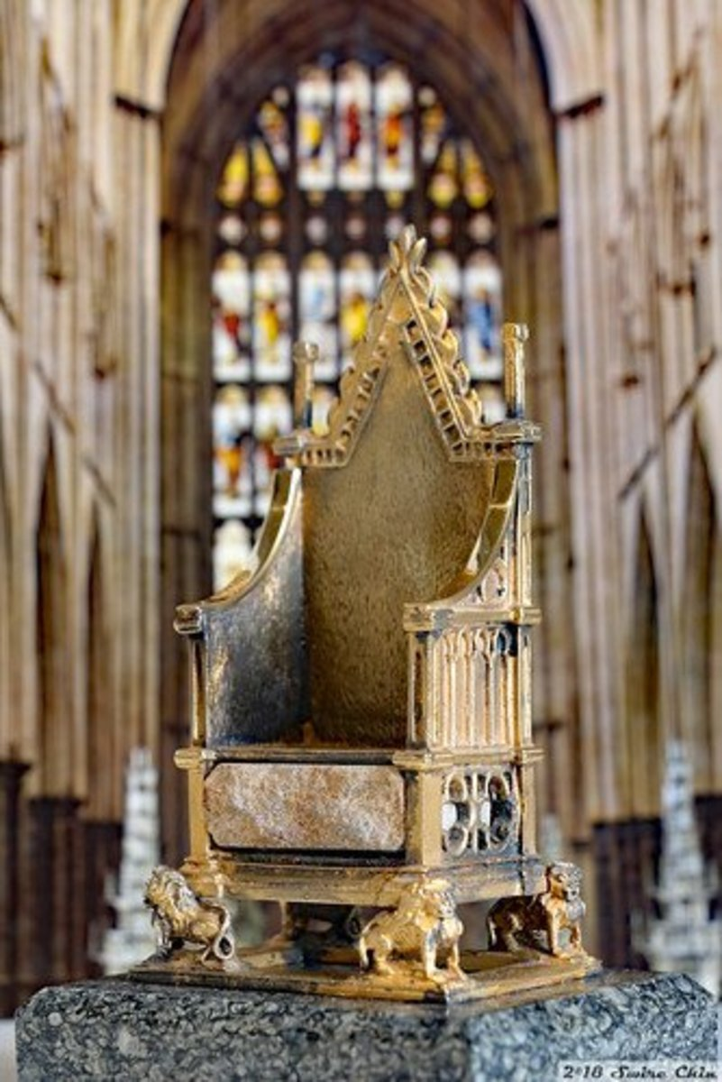 A silver gilt model of the coronation chair made to commemorate Queen Elizabeth II's silver jubilee.