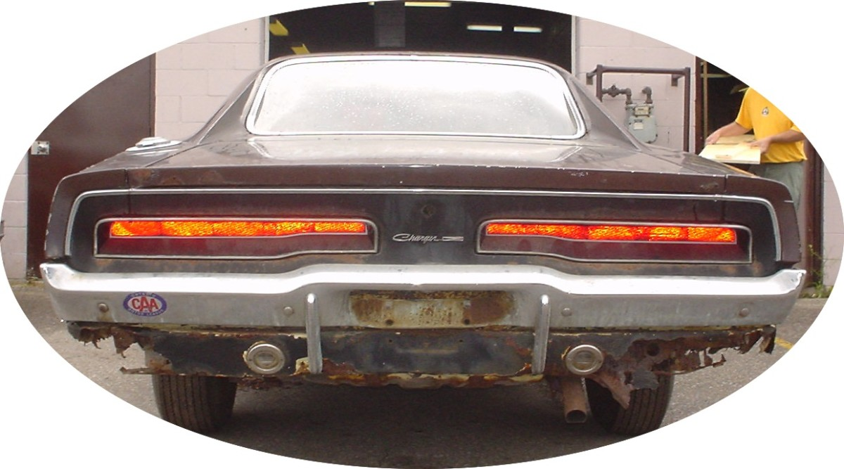 1969 Dodge Charger - rear view with a lot of rust on the rear valence