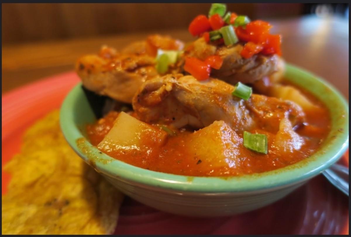 A delicious bowl of Puerto Rican pollo guisado