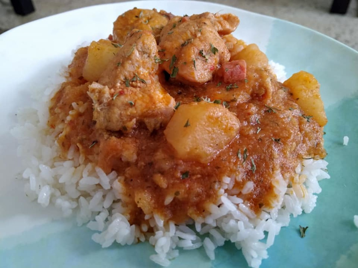 Pollo guisado is traditionally served over white rice
