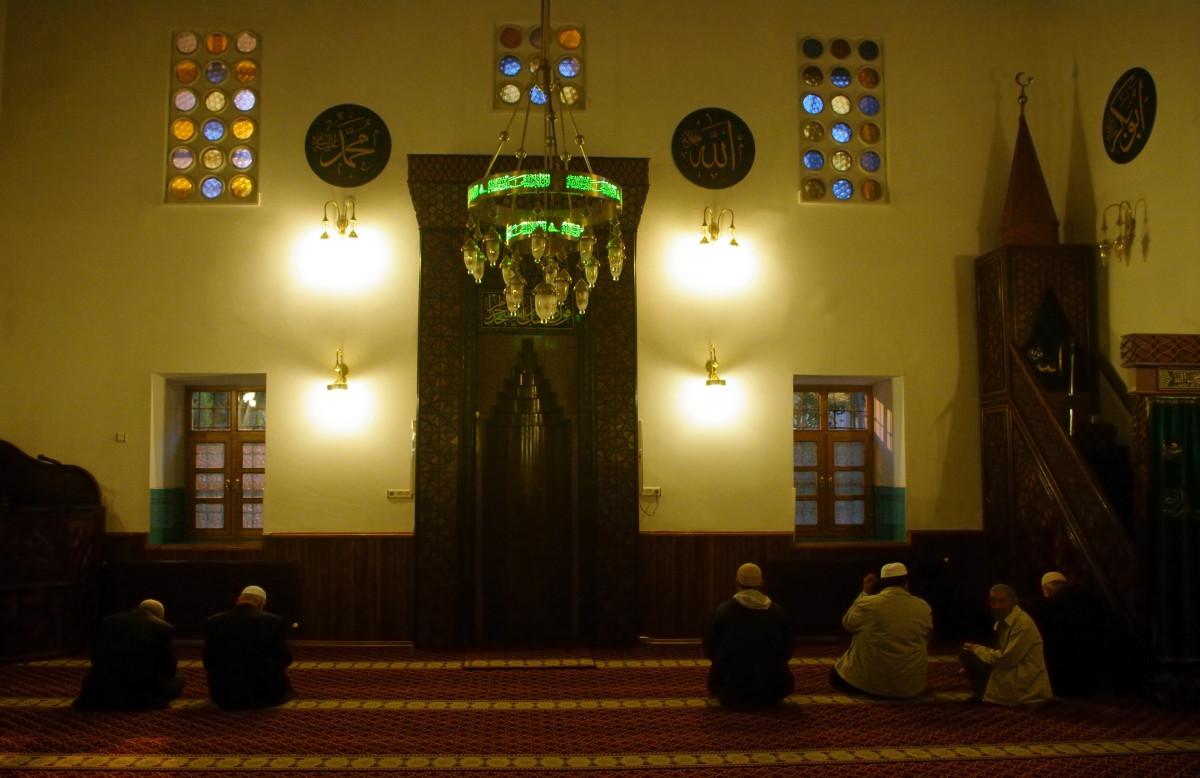 An interior view of Shams Tabrizi Mosque at an evening Salah time. Konya - Turkey.