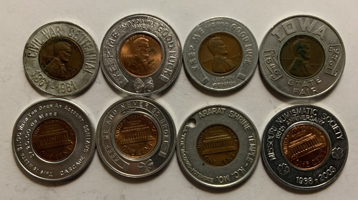 Eight different typical encased cents in circular holders. The four top examples show the obverses, while the four bottom examples show reverses. Examples like these normally sell in the $3 to $10 range.