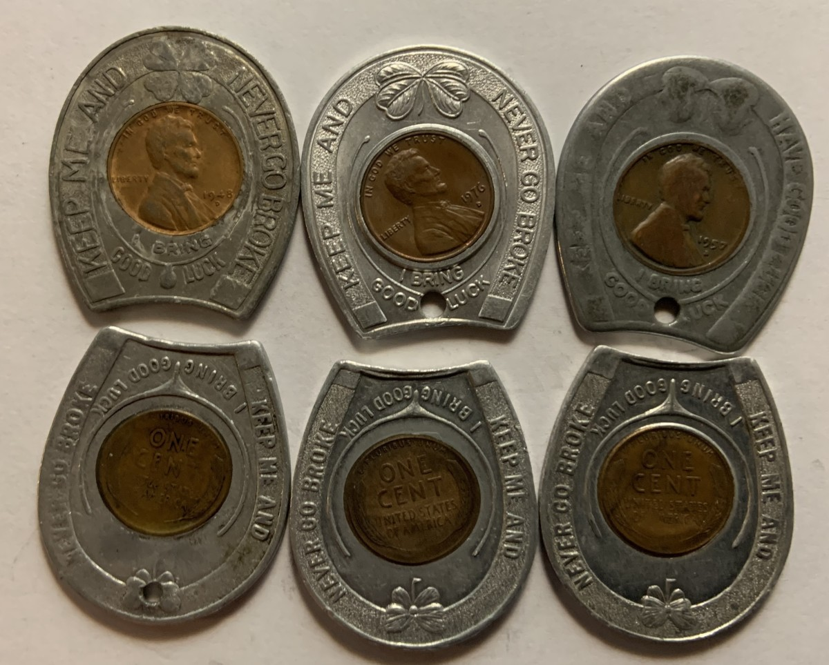 Six different typical encased cents in horseshoe shaped holders. The three top examples show the obverses, while the three bottom examples show reverses. Examples like these normally sell in the $5 to $10 range.