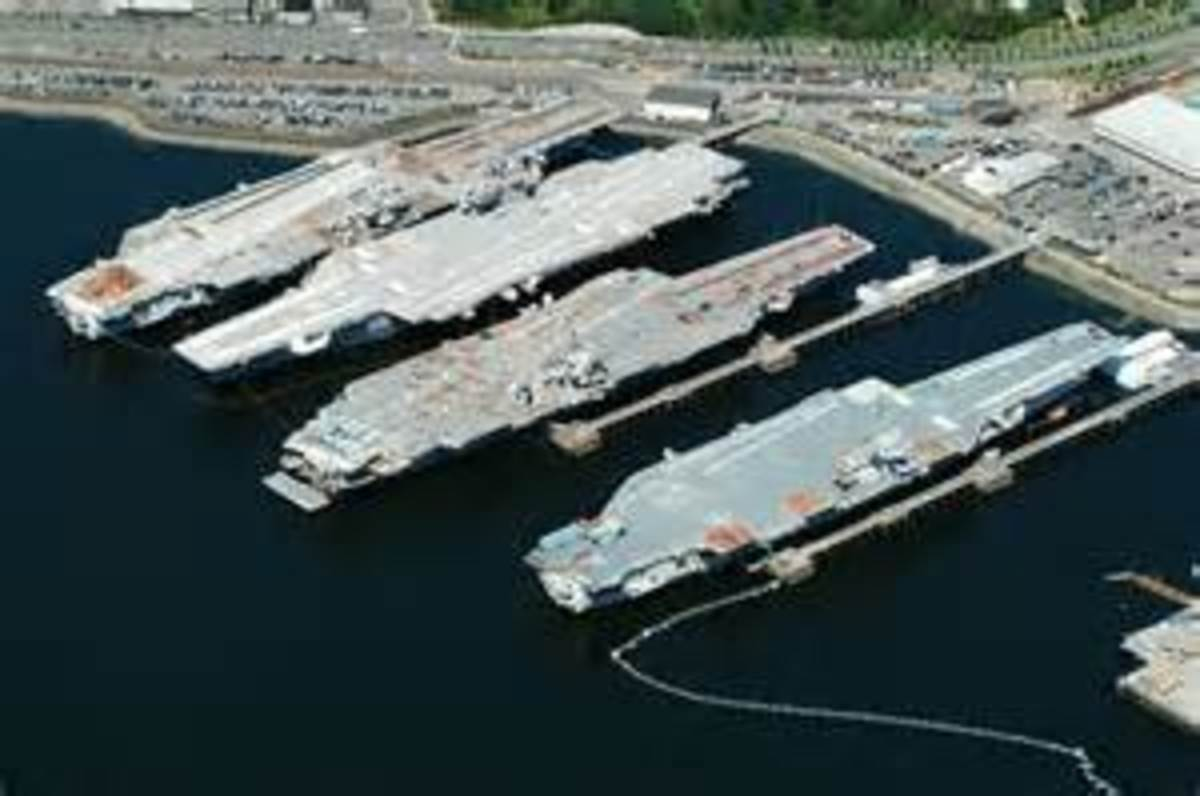 "Bremernton Yard-The carrier on the end has to be CV-31...as sitting moored in the ""Mothball fleet""."