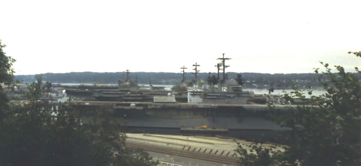 "She sits in the back of the row in this photo (taken 1988) at the Puget Sound Naval Shipyard. There...She sat as part of the ""mothball"" fleet after being decommissioned in 1971 until she was scrapped in 1992. Goodbye,Ol'Girl...You served us well!"