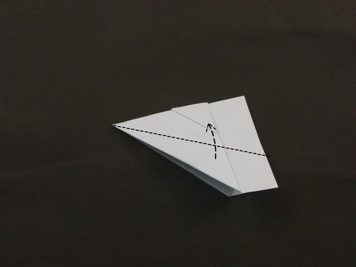 To make  the wings of the plane fold the wings as shown