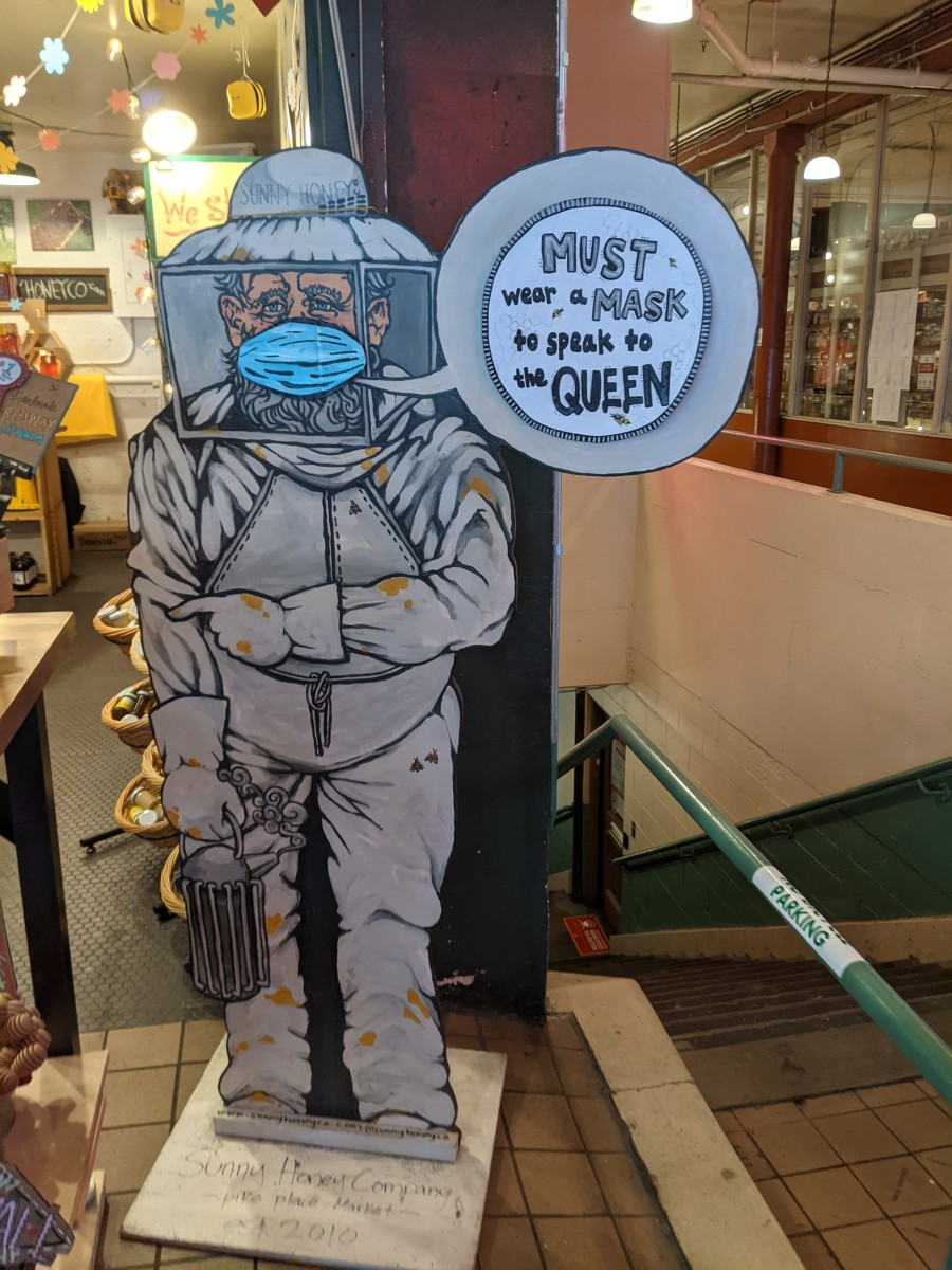 Mask notice at entrance to a shop selling honey in Seattle's historic Pike Place Market