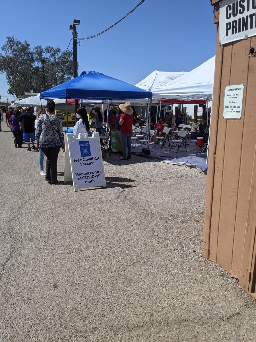 Tent at a Cinco de Mayo event in Tucson dispensing walk-in COVID immunizations