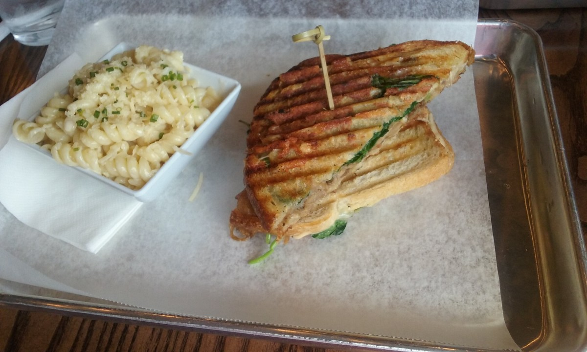 Served on a waxed paper lined metal tray for restaurant customers who dine-in at the restaurant, the duck club sandwich is one of my favorite food items to order from Melt Kitchen & Bar restaurant. A tasty pasta salad accompanies the duck sandwich.