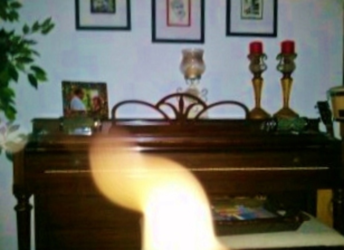 In this photo I've captured the spirit generated essence of Mary Duggan at her beloved piano. I watched a key move.