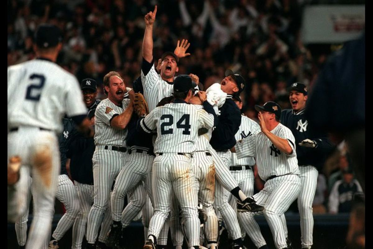 Yankees celebrating 1996 World Series, Derek Jeter Pictured in Left Corner of image.