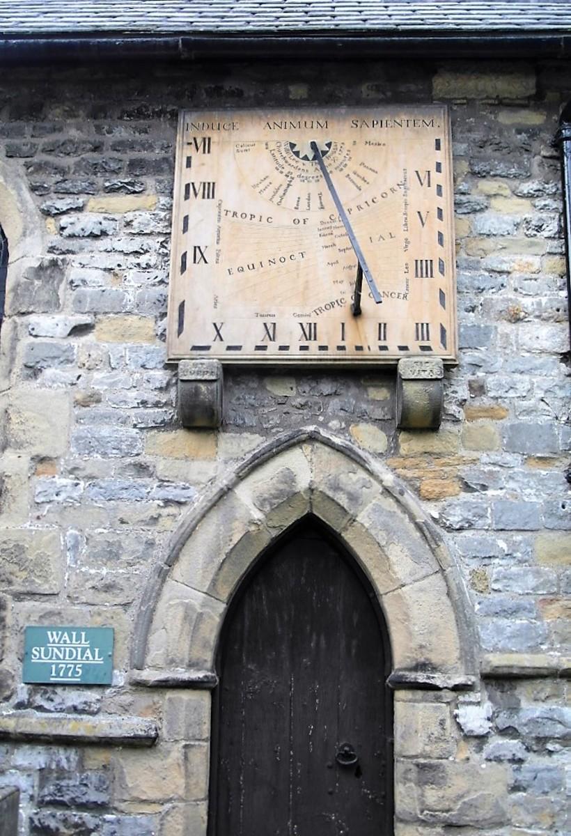 The sundial on Eyam Parish Church.