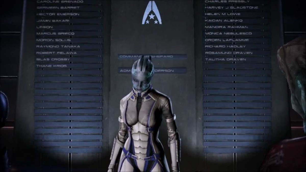 Liara places Shepard's name on the memorial wall.