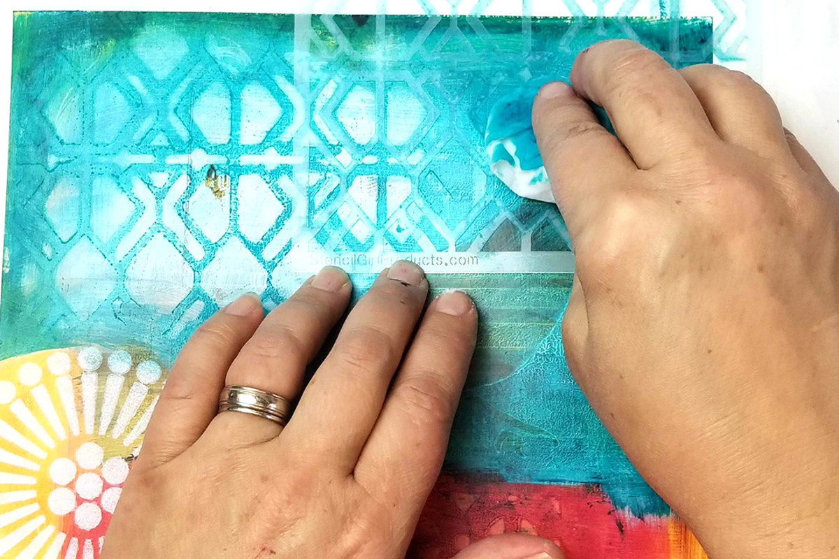 Stencils and gesso...use basic colors of gesso or add some acrylic paint to make colored gesso to use with your stencils