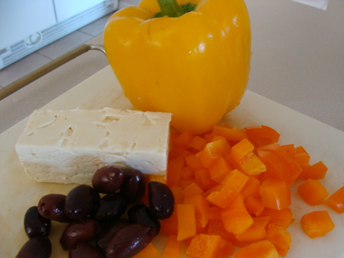 Chop the vegetables so that are about 1/4 inch squares.  Leave the feta cheese in about 1/2 inch chunks.