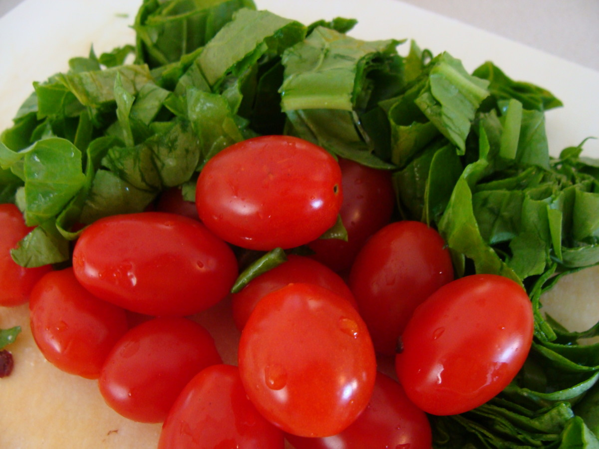 Fresh tomatoes and spinach are added to the salad.