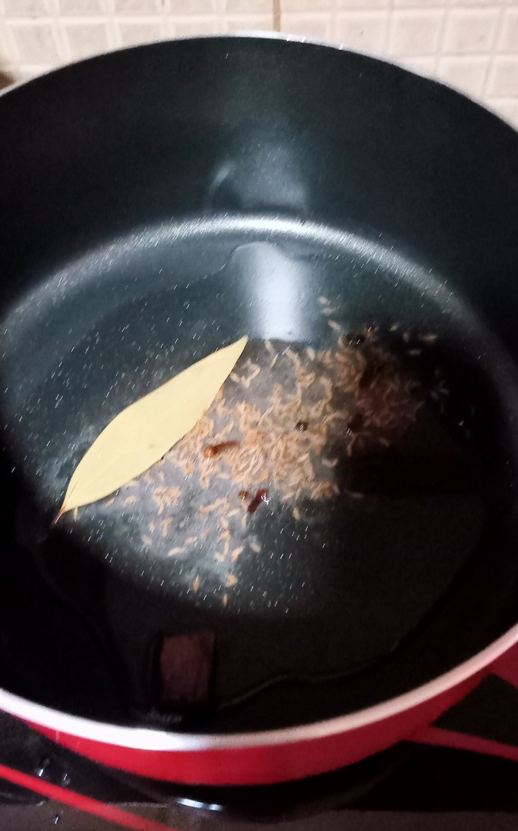 Heat oil and add dry spices.