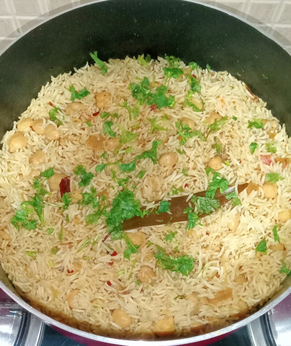 Yummy white chickpea pulao garnished with coriander leaves