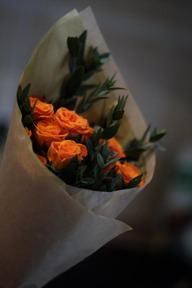 Paper roses in a paper wrap.