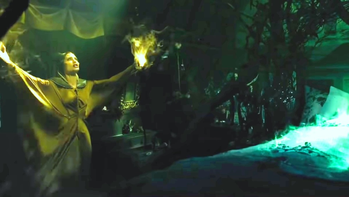 Maleficent tries to take that curse back while using her powers.