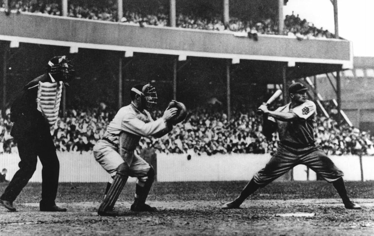 Catcher Roger Bresnahan awaits a pitch as fellow Hall of Famer Honus Wagner bats.