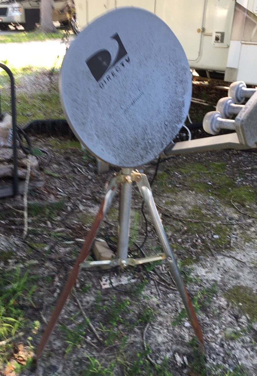 A typical DirecTv satellite antenna requiring manual alignment for good reception that you will find being used in campgrounds.