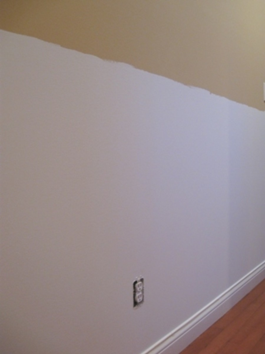 The next day, my husband sanded the wall to give it a very even, smooth texture. Luckily we found no holes or anything that needed filling and sanded. Next, I removed any wall plates and taped off the area around door ways and the baseboard, cleaned