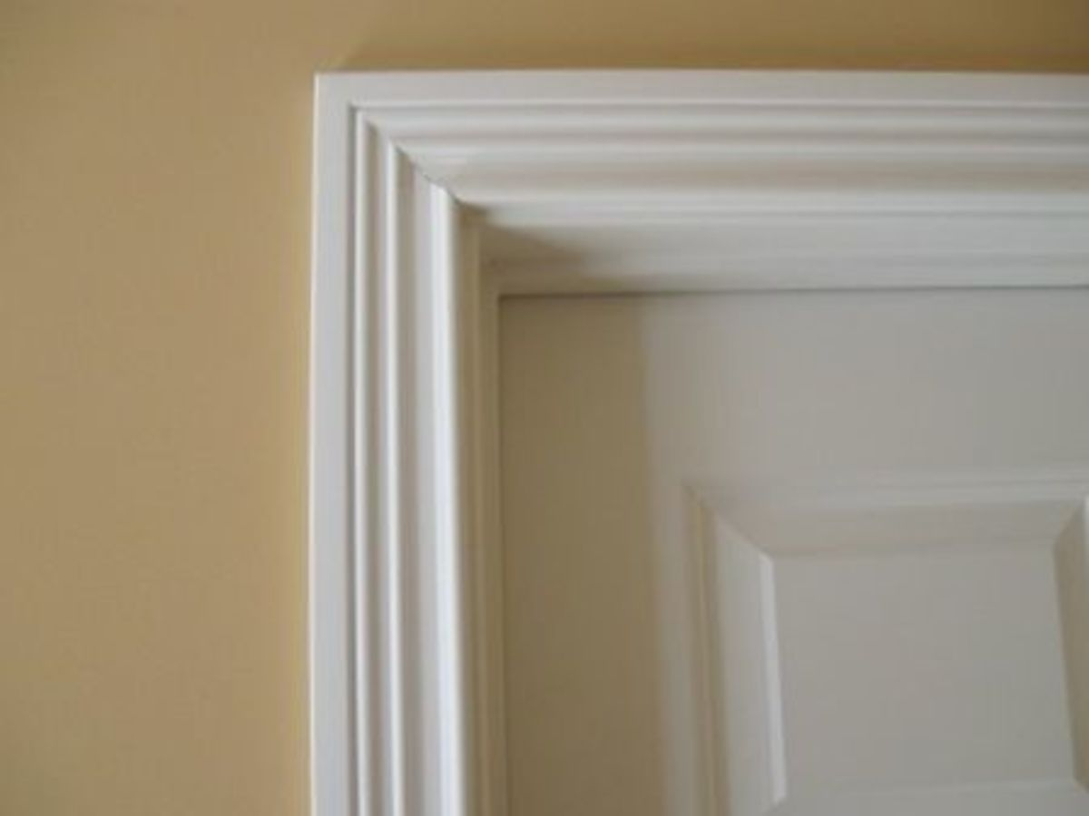A trip to the store was next to choose our moulding and chair rail. I took along a picture of the trim work around our doors to help in making the choice for the chair rail. We didn't get a matching trim because it wasn't as wide or have as high of a