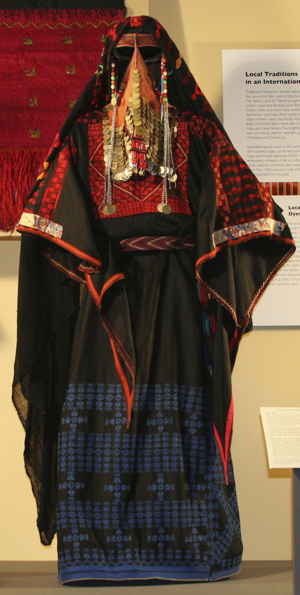 semi-nomadic Bedouin garment: The color of the embroidery of the lower back and front part of the thob skirt indicates the woman's marital status Only married women embroidered their dresses in red, orange, yellow, and green; unmarried girls and wido