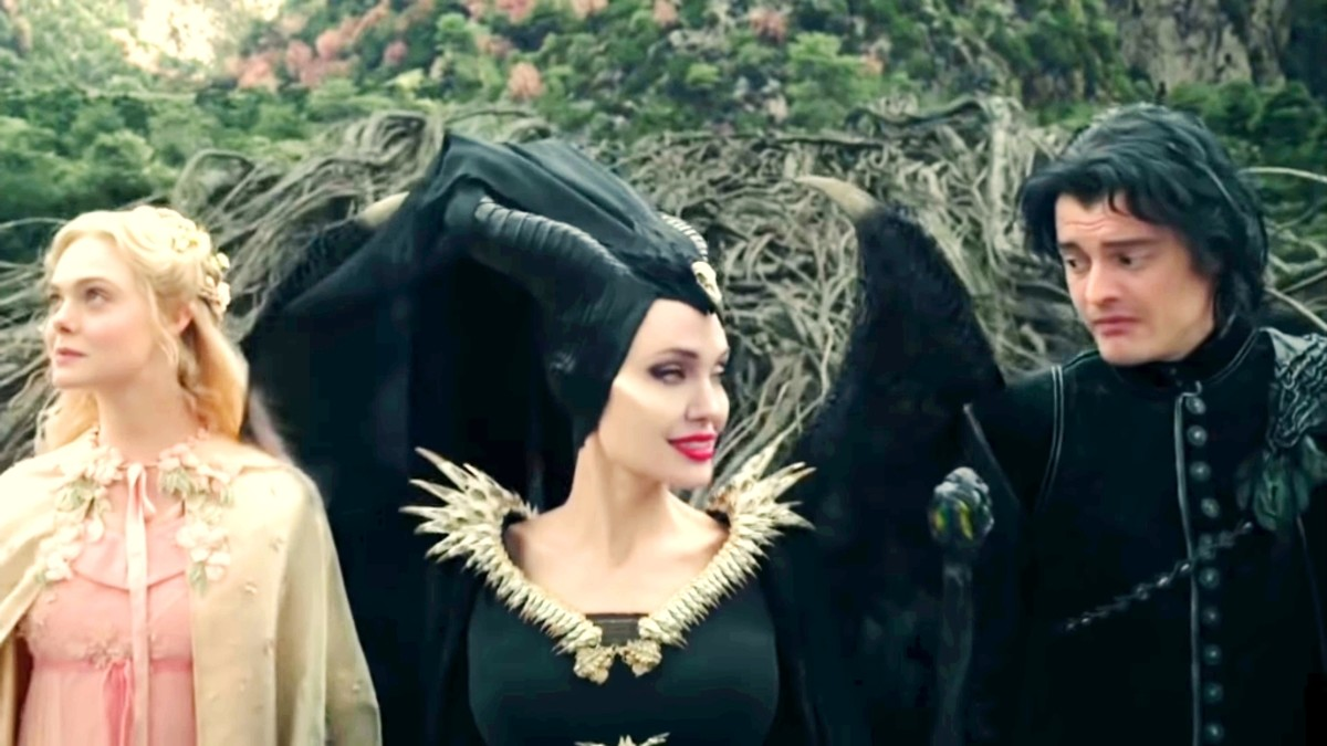 Maleficent, her crow who was in the form of a human, and princess Aurora.They get ready in the forest to go to dinner.