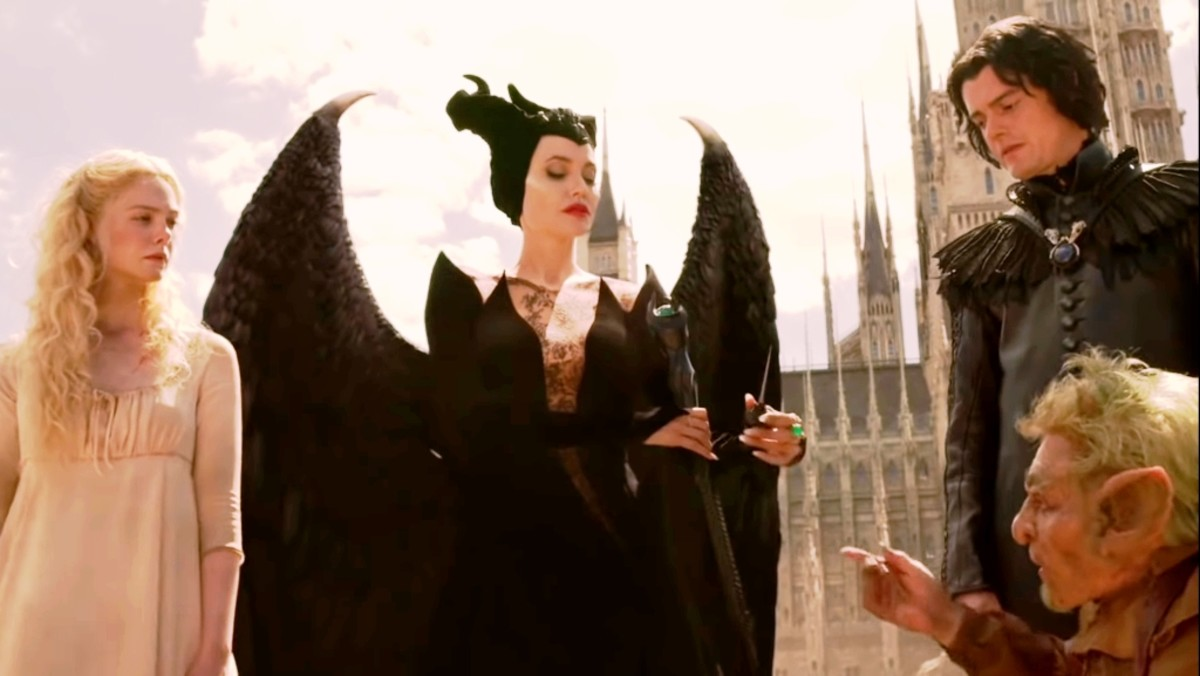 the little man also comes to Maleficent who had captured the two creatures.He frees her creatures and gives her the needle with which he spreads the curse.