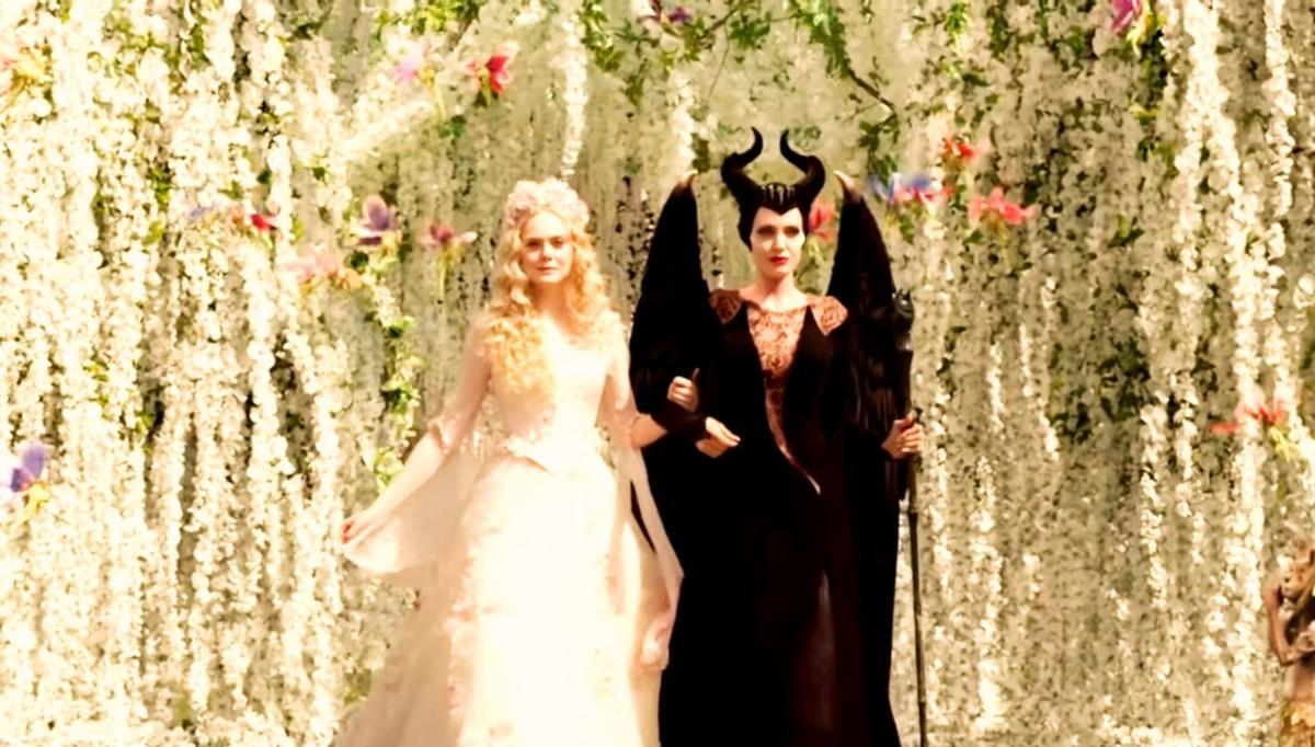 Aurora wears the wedding dress.