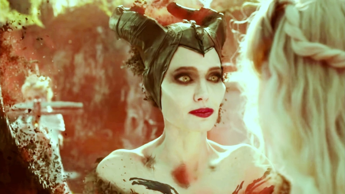 As the arrow shoots at Maleficent, she turns into ashes.