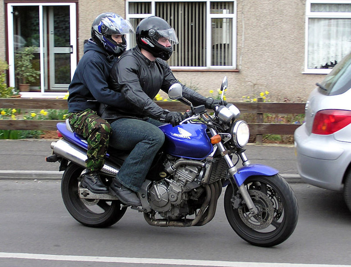 Ride your motorcycle to work today, and bring along a friend.