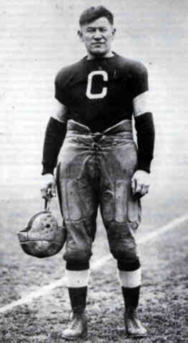 Jim Thorpe in football uniform. Jim Thorpe Native American Games. 8th-14th--wikimedia commons