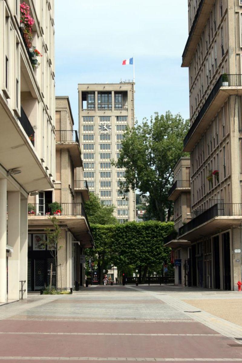 A glimpse of the Town Hall's clock tower along Rue Robert de Villehervé