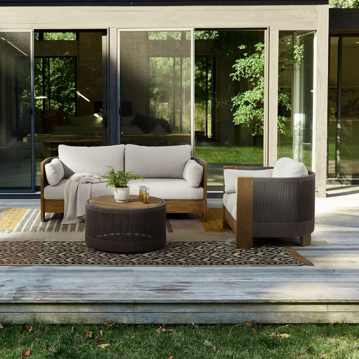 The the cushioned couches and armchairs that are deck-smart faux wicker and teak.