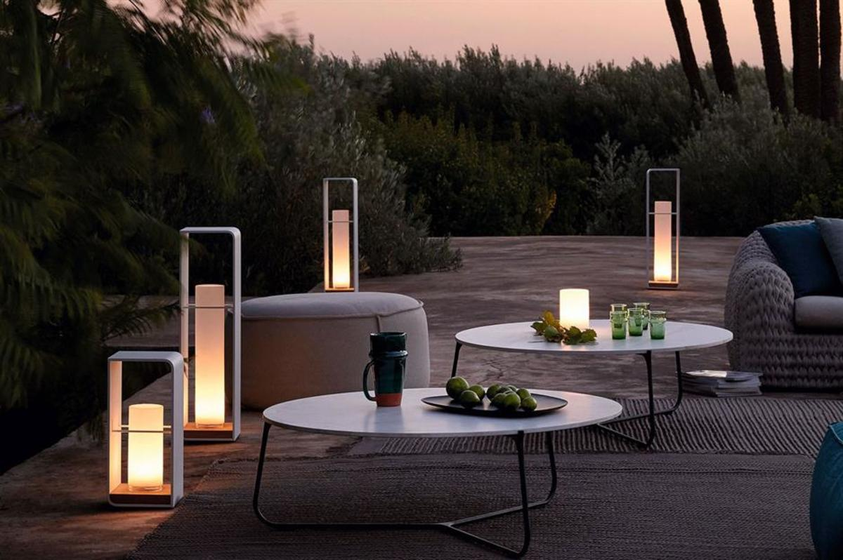 The looking for garden lighting with a contemporary twist these outdoor charger lanterns with teak bases and powder-coated aluminium frames will look the part.
