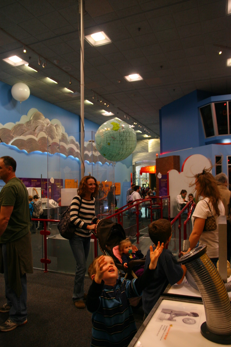 Exploring concepts of air pressure in a hands-on physics lab at the Air and Space Museum.