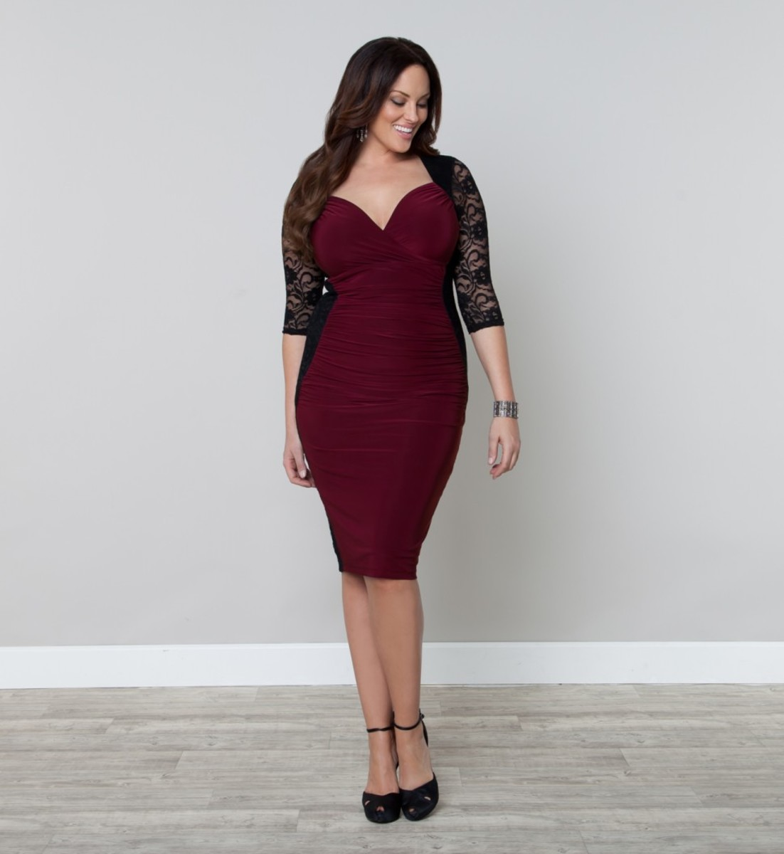 Be stunning in this lovely ruched dress from Kiyonna.