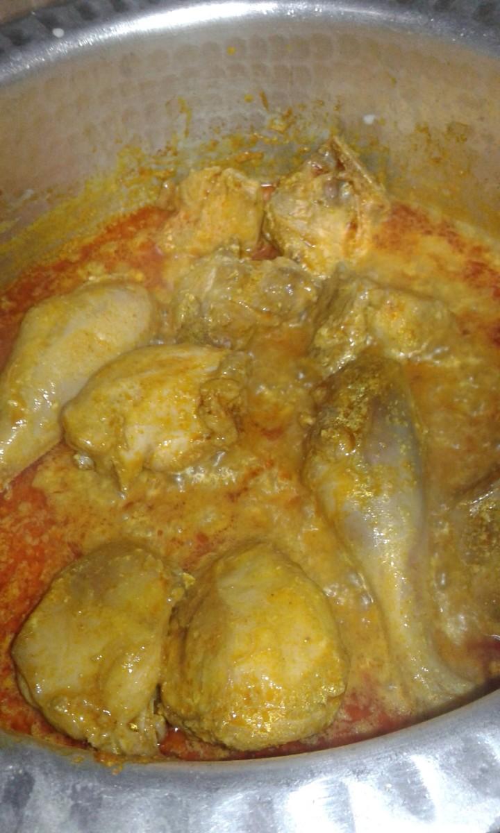 Add red chili powder, coriander powder, turmeric powder, salt, curd and mix well.
