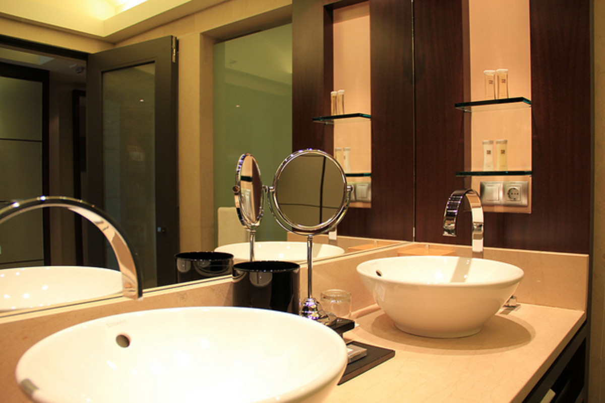 Vessel sinks, quartz counters and dark cabinetry will give your bathroom a spa feel.