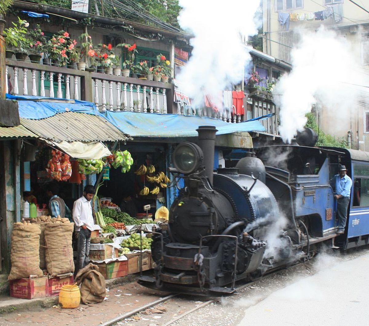 The darjeeling rail crosses close to shops