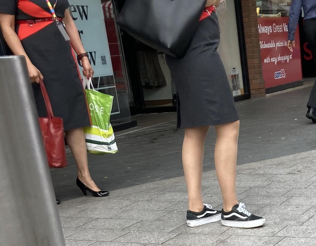 Two women in London.  One of these pairs of shoes could easily be worn by a man in public.